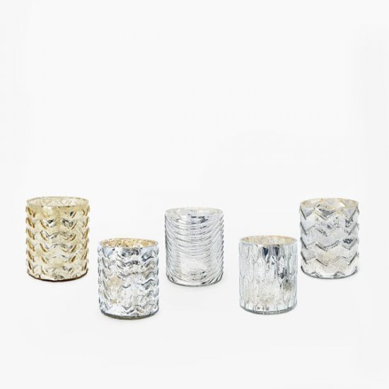 Votive candles placed all around your home look so festive and set the party mood.